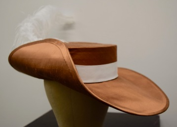 Patterned and built copper silk-covered buckram hat
