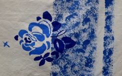 Two-tone screen print floral design with sponged border and hand-painted details