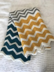 Baby blanket knit in chevron pattern