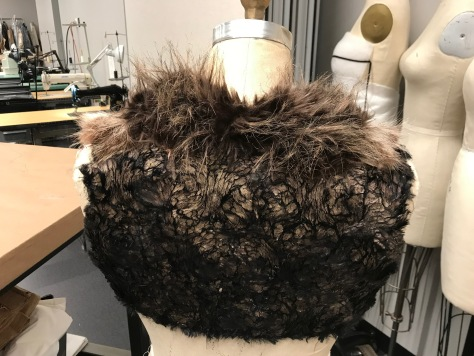 Draped and built short fake fur vest with real fur accents